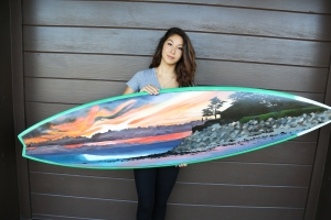 1Laura holds board